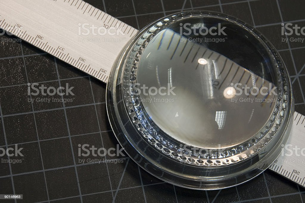 Magnifying Glass Over Ruler royalty-free stock photo