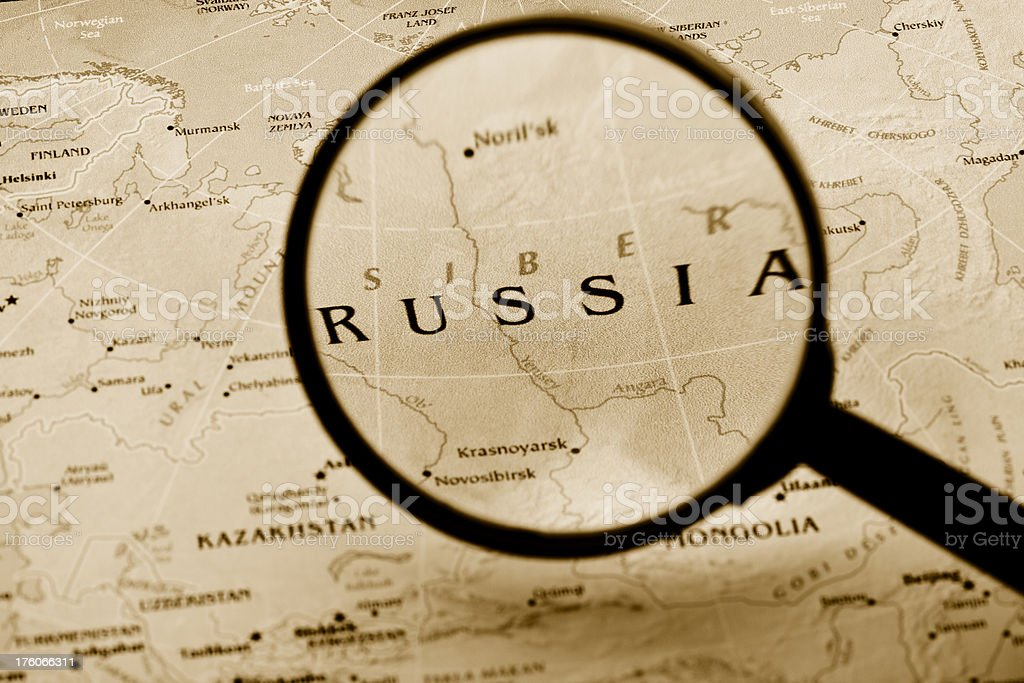 Magnifying glass over Russia in a map. (XXL) royalty-free stock photo