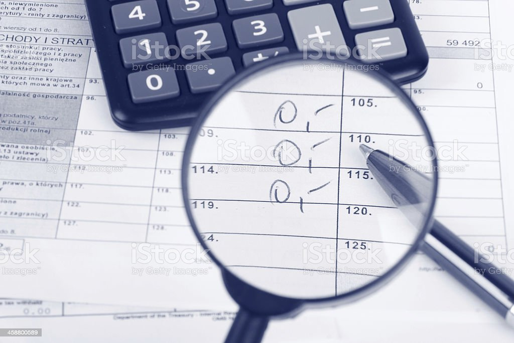 Magnifying glass over the tax form royalty-free stock photo