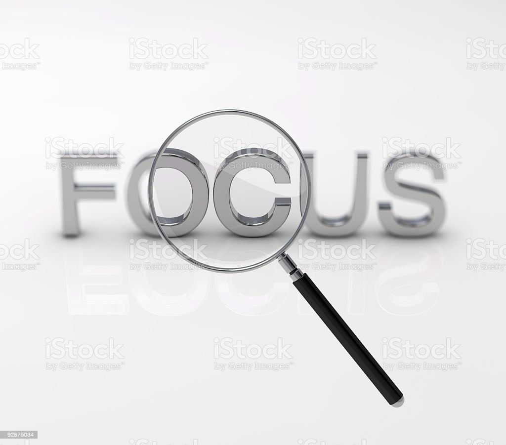 Magnifying glass over the word focus royalty-free stock photo