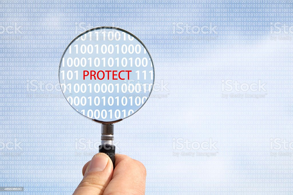 magnifying glass protect concept stock photo