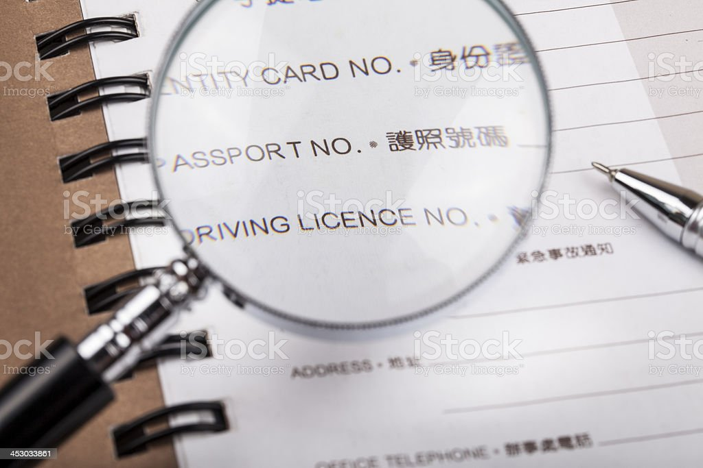 Magnifying glass to see Profile stock photo