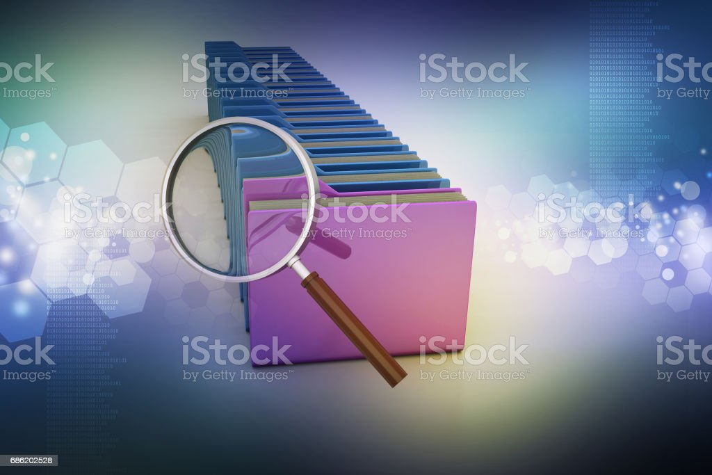 Magnifying glass with file folder stock photo