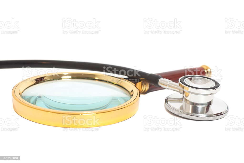 Magnifying Glass With Stethoscope isolated on white.Health concept stock photo