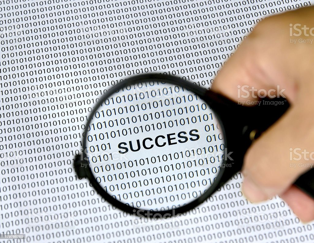 Magnifying glass with success word on background . stock photo