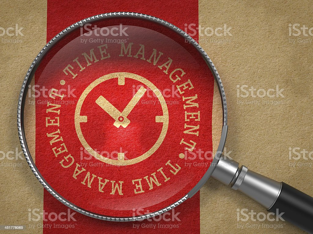 Magnifying Glass with Time Management Concept. stock photo