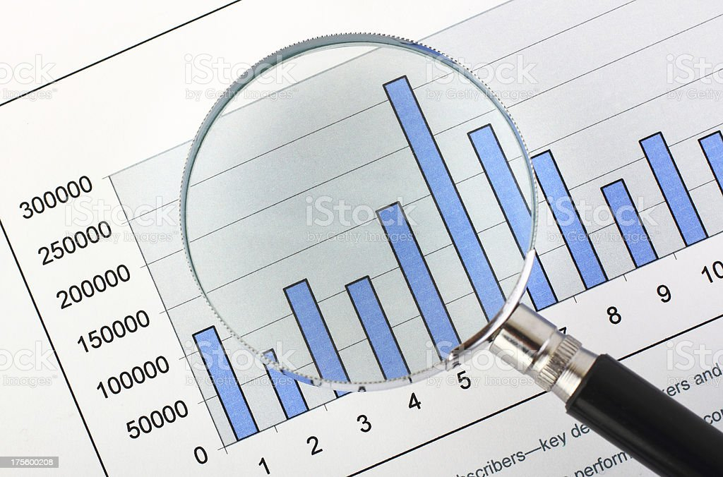Magnifying glass,on business graph stock photo