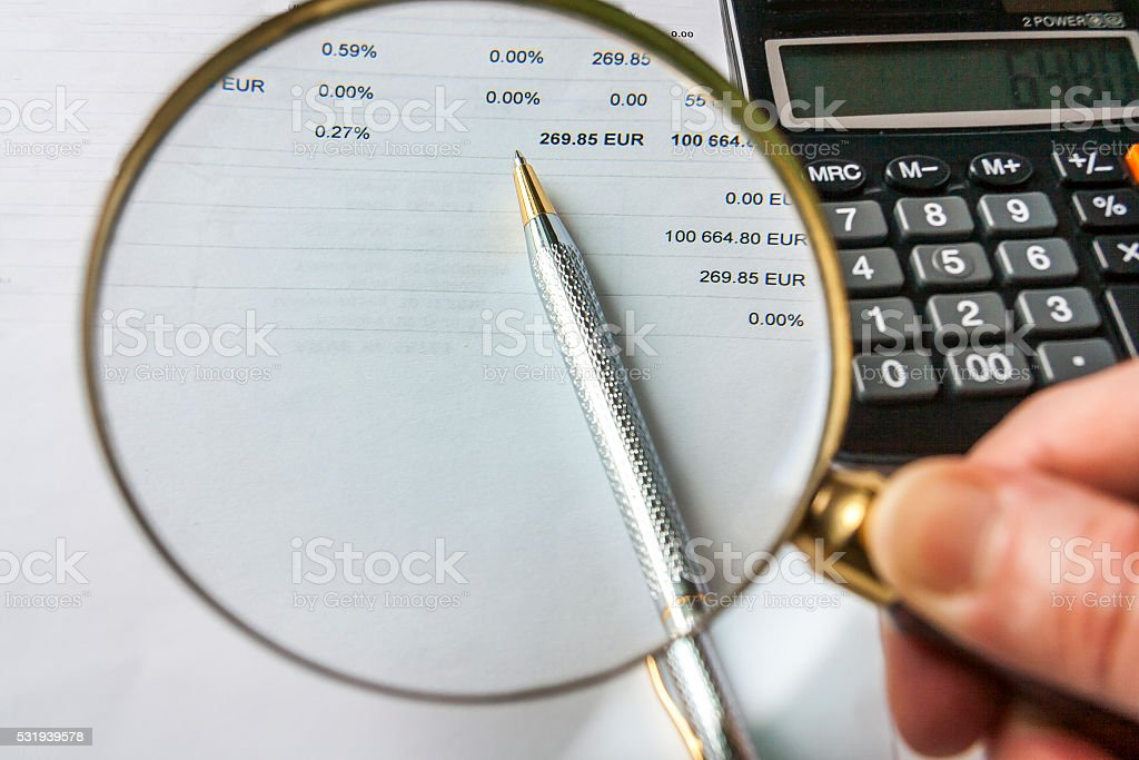 Magnifying Glass,Pen And Calculator on Financial Document stock photo