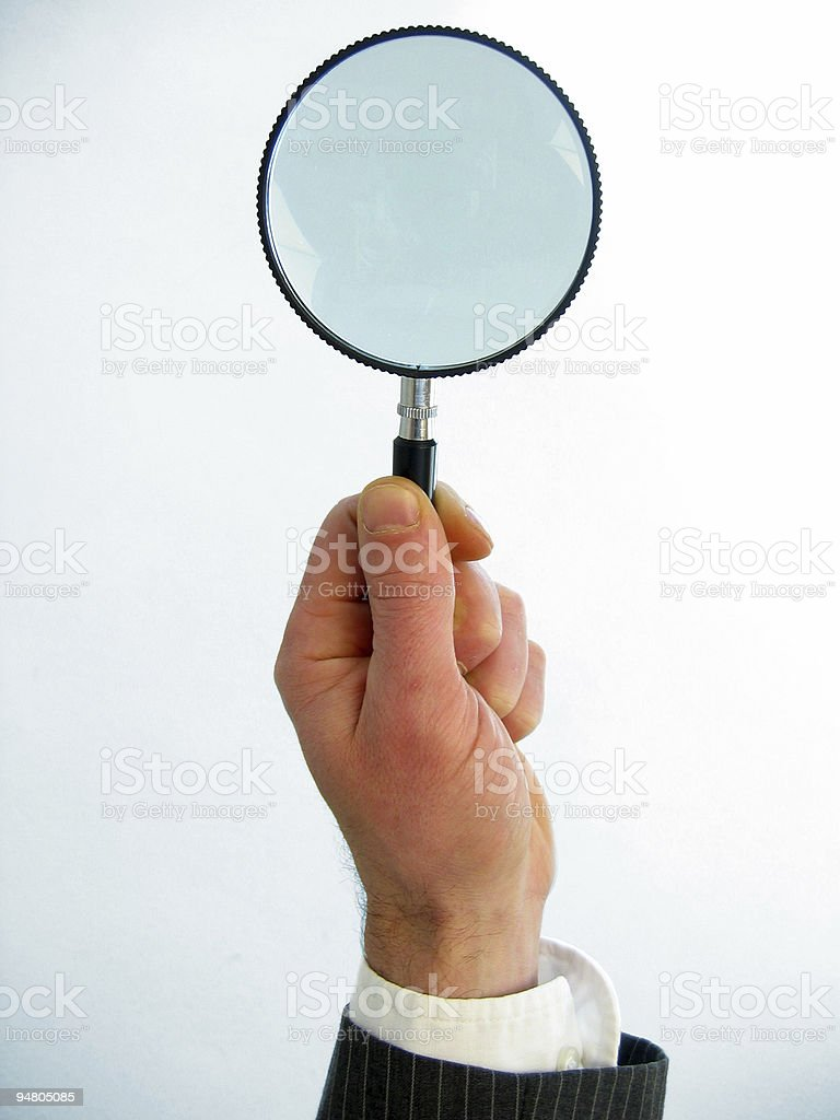 magnifying hand royalty-free stock photo