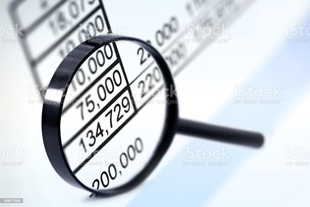 A magnifying lens focusing on the numeric figures royalty-free stock photo