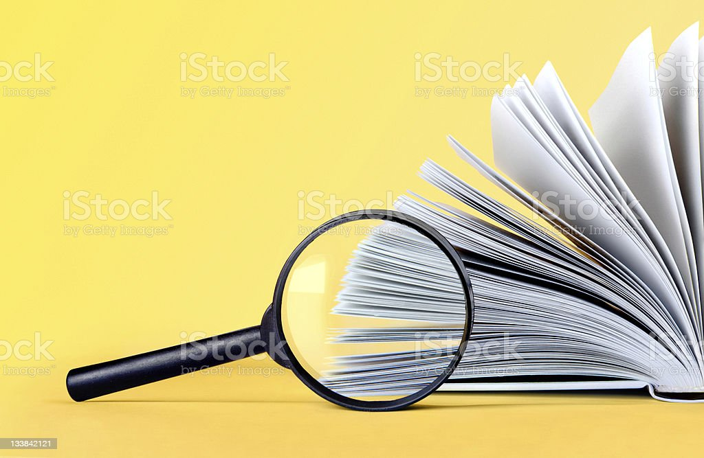 magnifying loupe and book stock photo