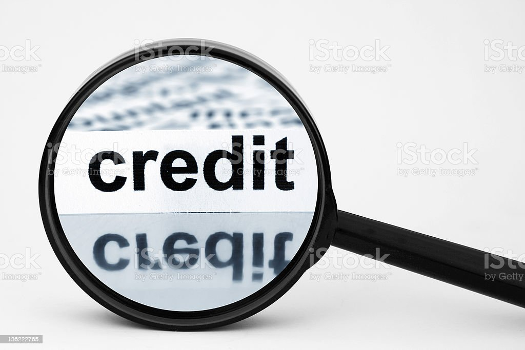 Magnifying the word credit in bold royalty-free stock photo