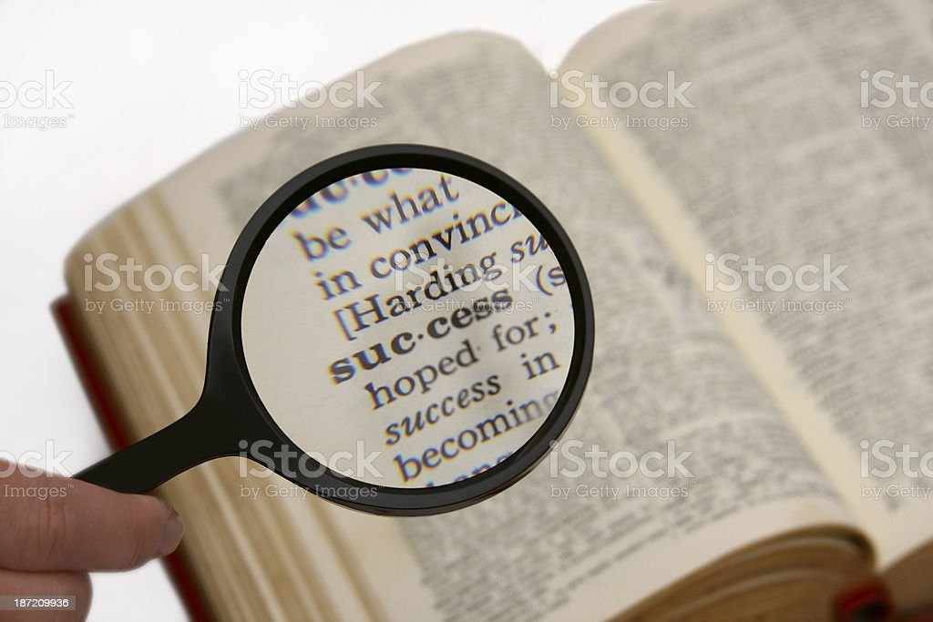 Magnifying the word Success from a Dictionary royalty-free stock photo