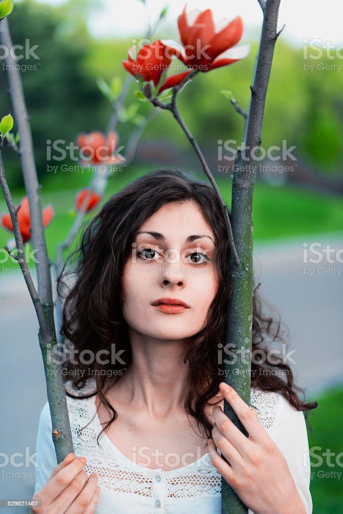 Magnolia tree and woman royalty-free stock photo