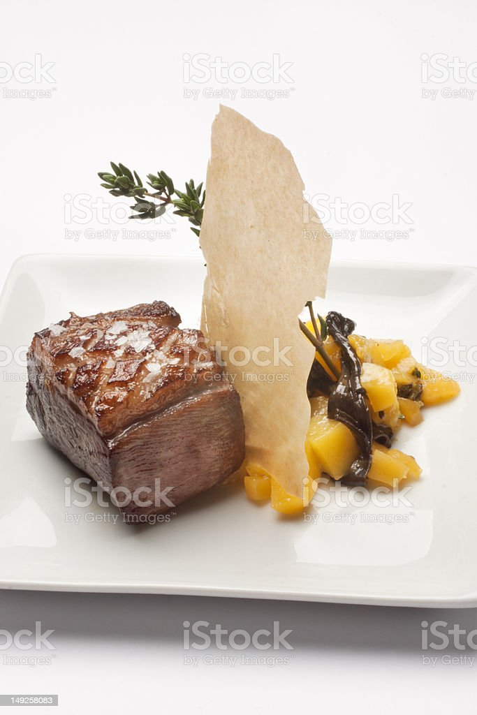 Magret duck with peach an salad royalty-free stock photo
