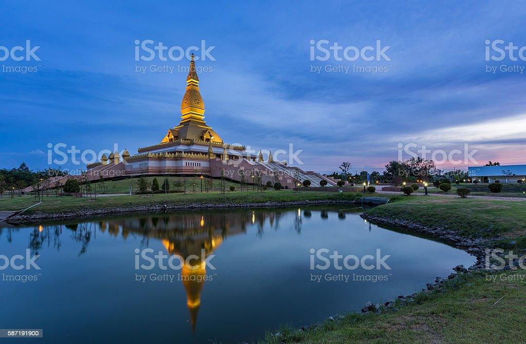 Maha Mongkol Bua Pagoda in Roi-ed Thailand at sunset. stock photo