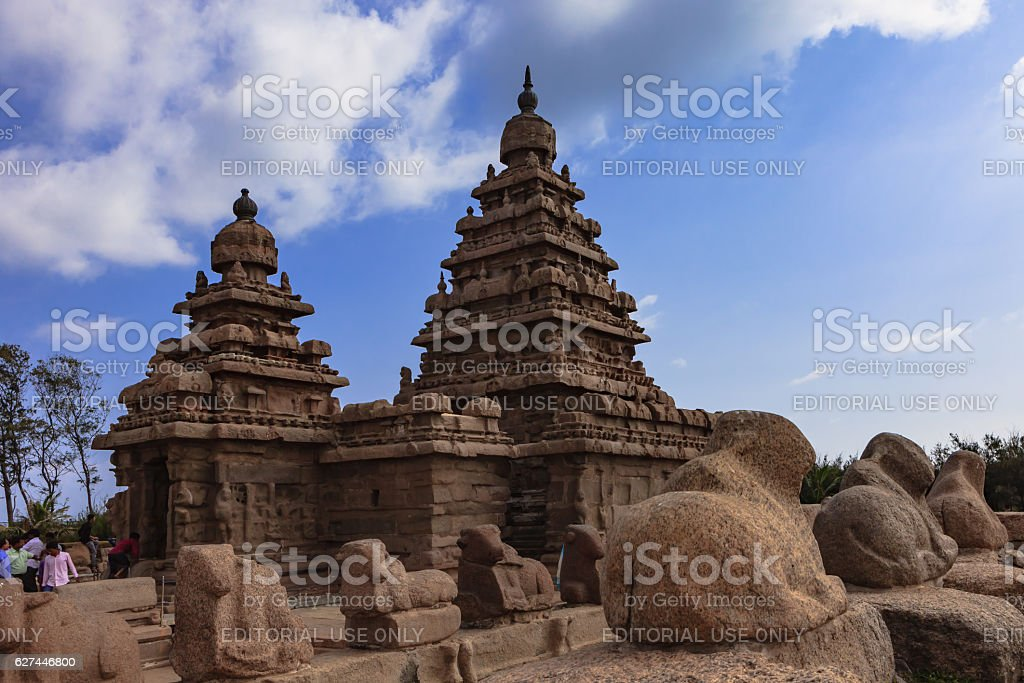 Mahabalipuram, India - Tourists at 8th Century Granite Shore Temple. stock photo
