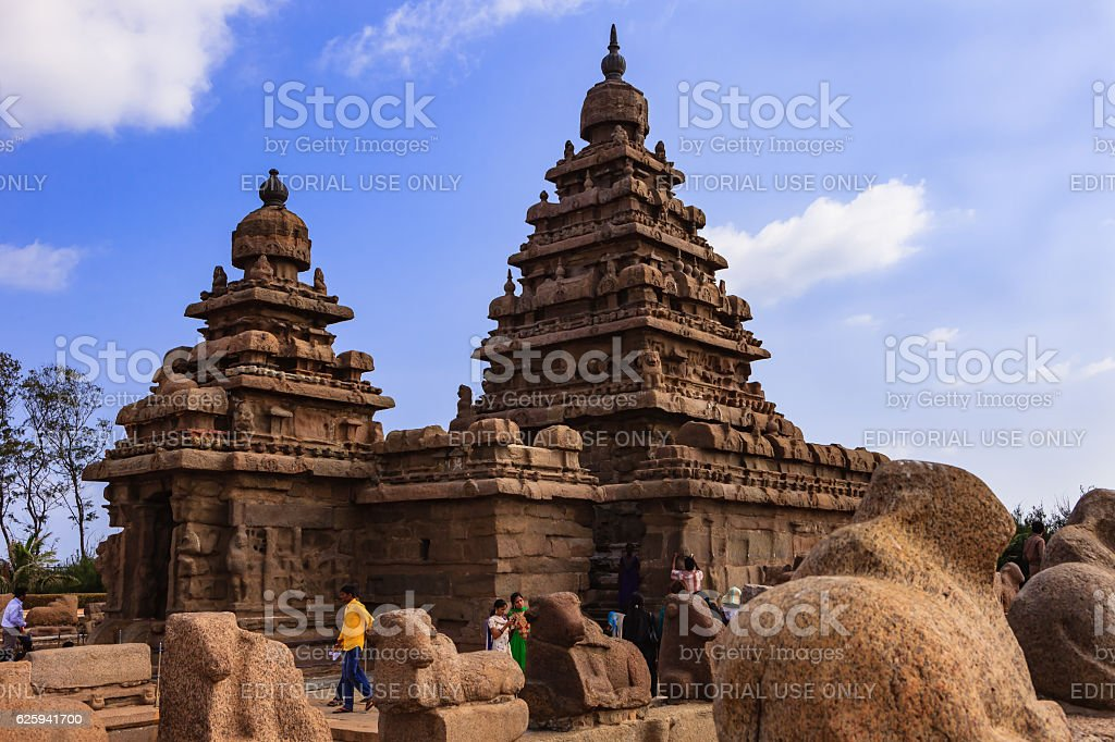 Mahabalipuram, India - Tourists at 8th Century Shore Temple. stock photo