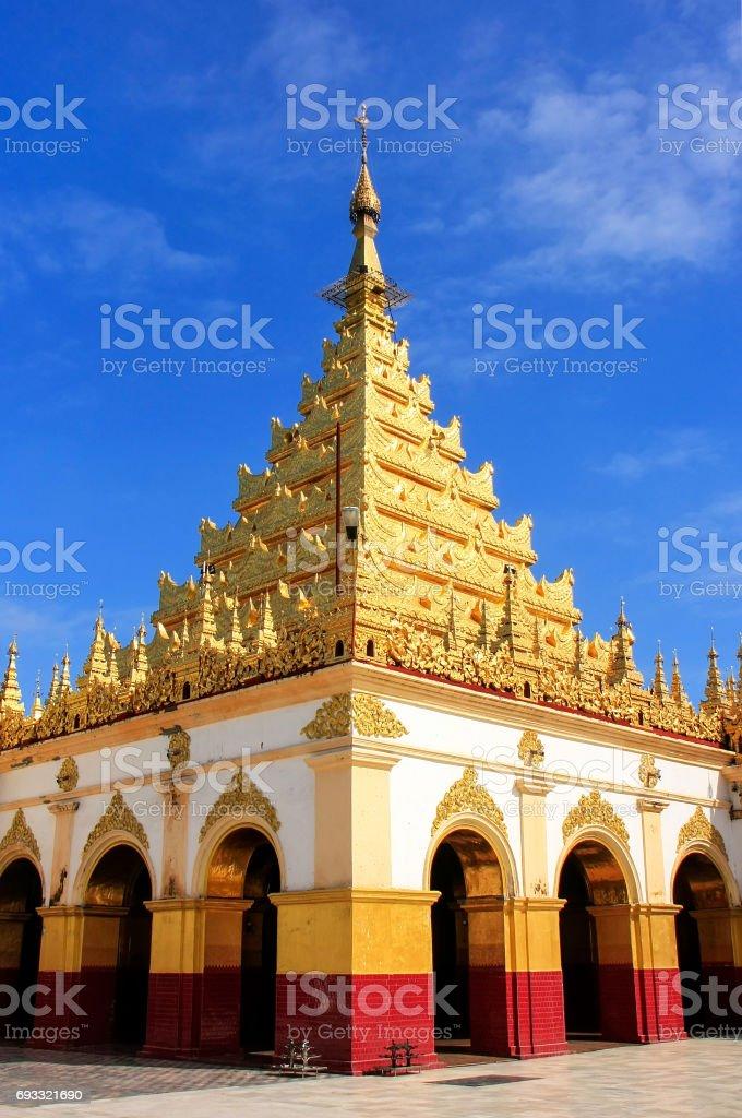 Mahamuni Pagoda on a blue sky day in Mandalay, Myanmar stock photo