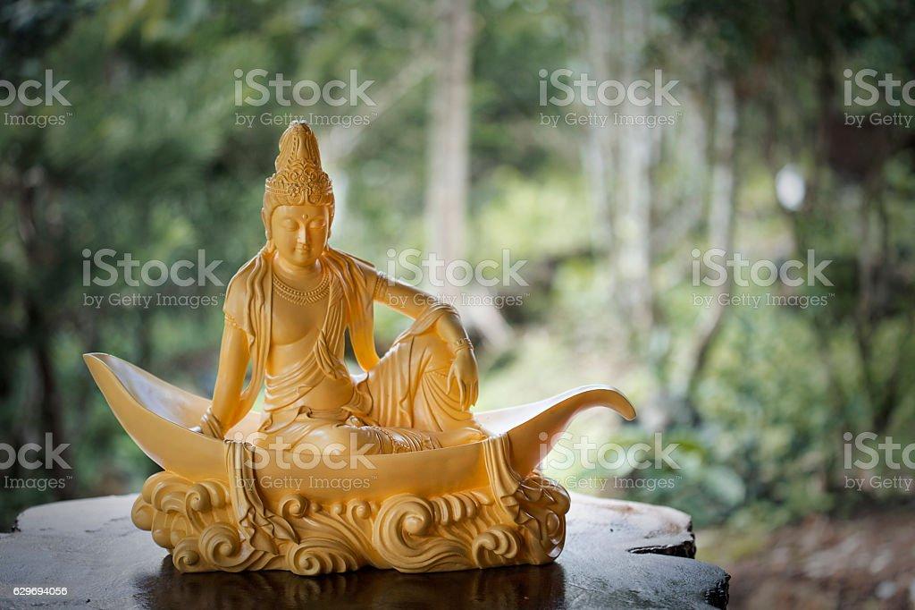 Mahasthamaprapta Bodhisattva sitting on lotus petal statue stock photo