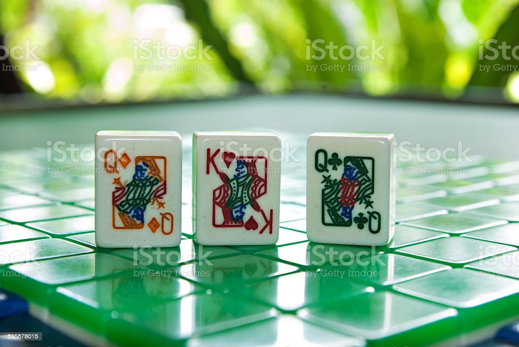 Mahjong tiles of the King of hearts with two queens stock photo