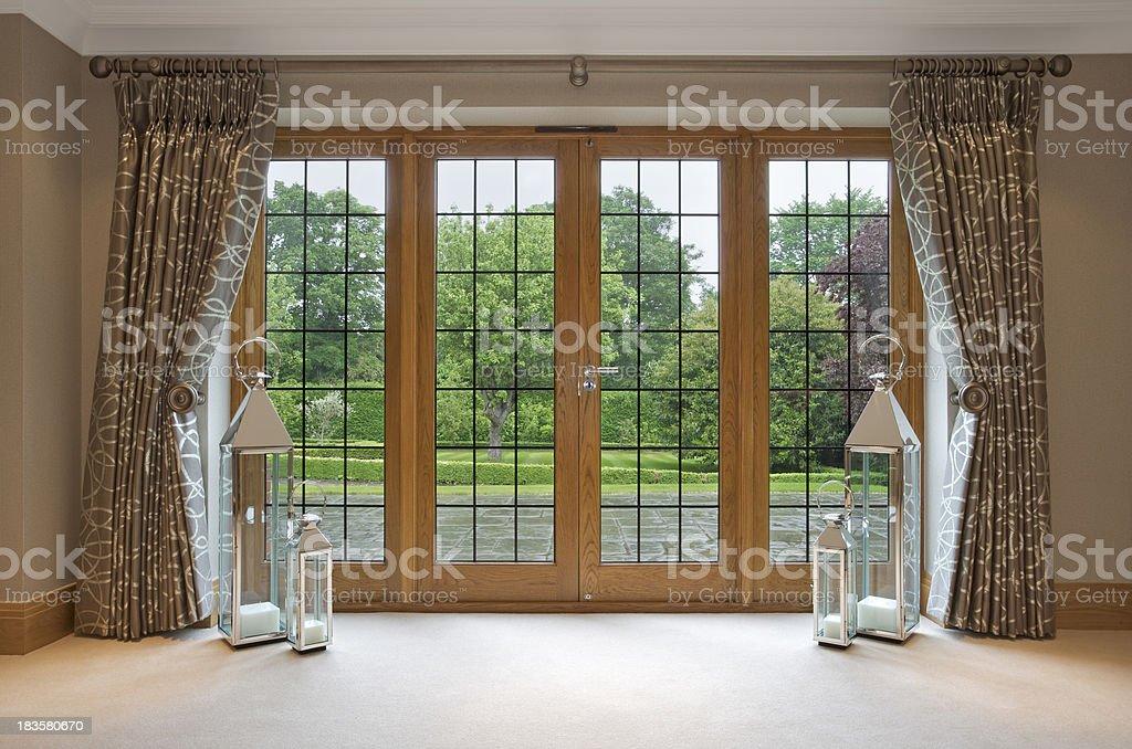 mahogany patio doors and garden view royalty-free stock photo