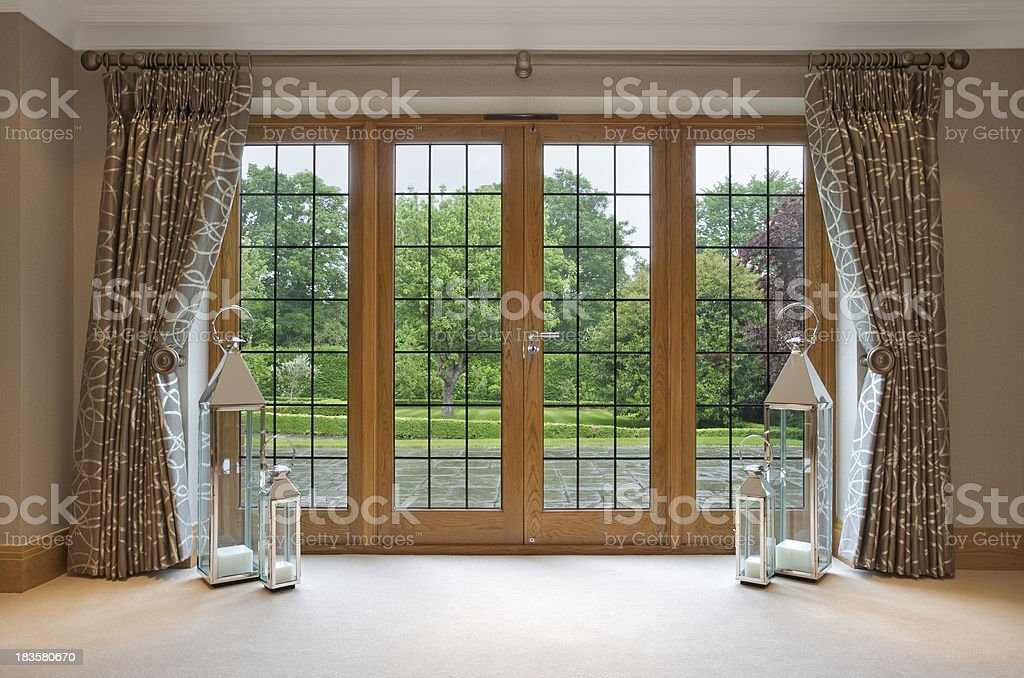 mahogany patio doors and garden view stock photo