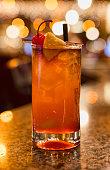 Mai Tai in bar with cherry and orange