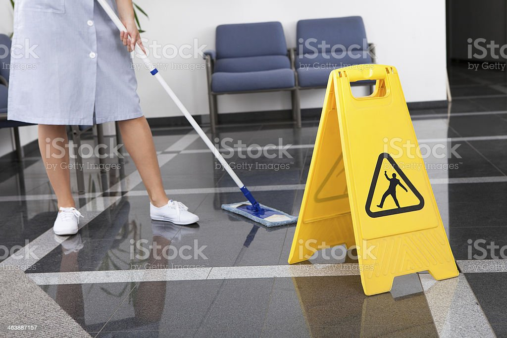 Maid Cleaning The Floor stock photo