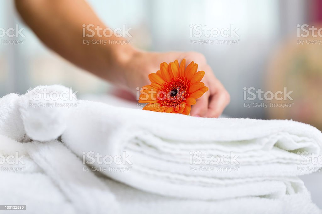 Maid doing room service in hotel stock photo