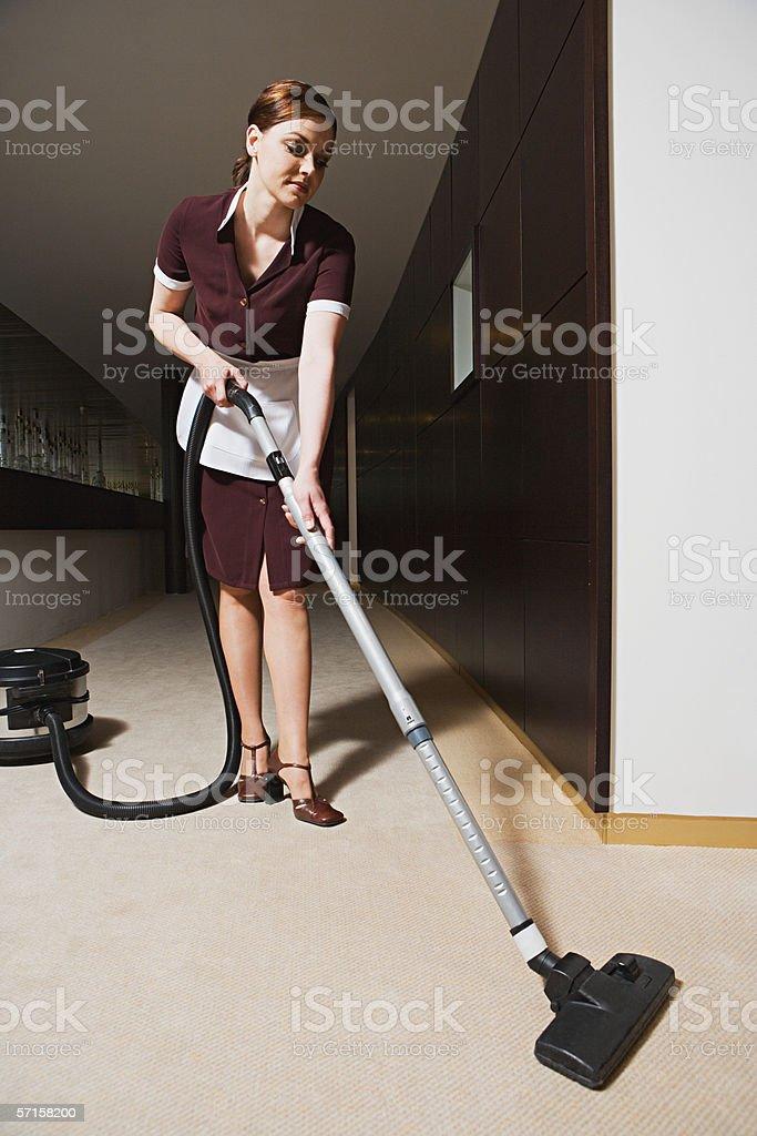 Maid hovering corridor stock photo