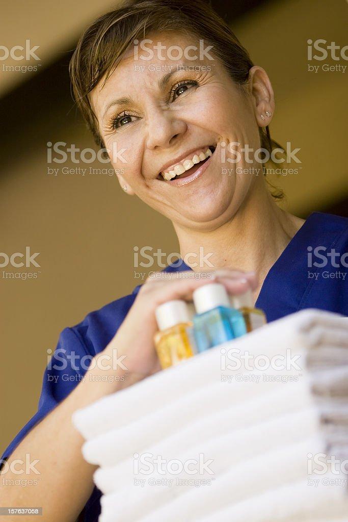 Maid service providing clean linens and extra toiletries stock photo