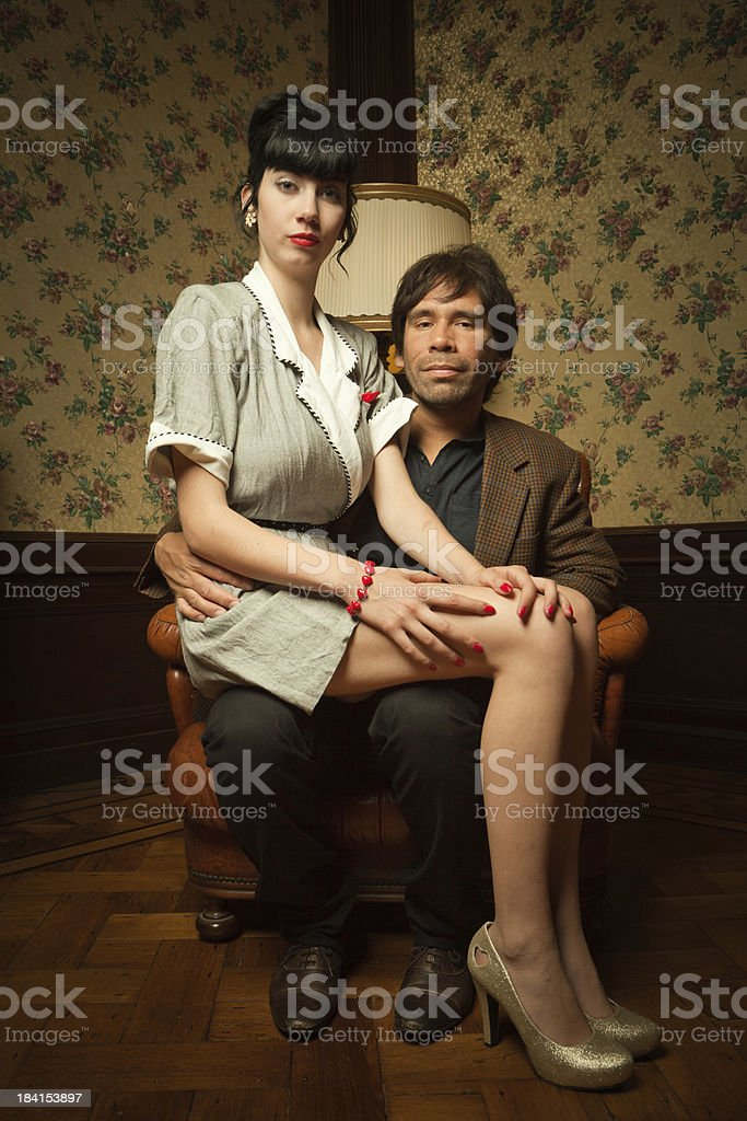 Maid sitting on gentleman's lap royalty-free stock photo