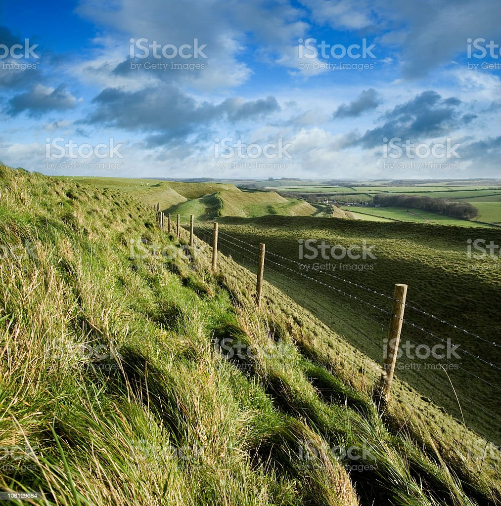 Maiden Castle Hill Fort in English Countryside royalty-free stock photo