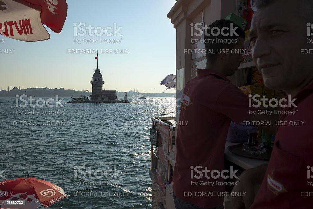 Maiden's Tower and cafe in Üsküdar, Istanbul, Turkey royalty-free stock photo