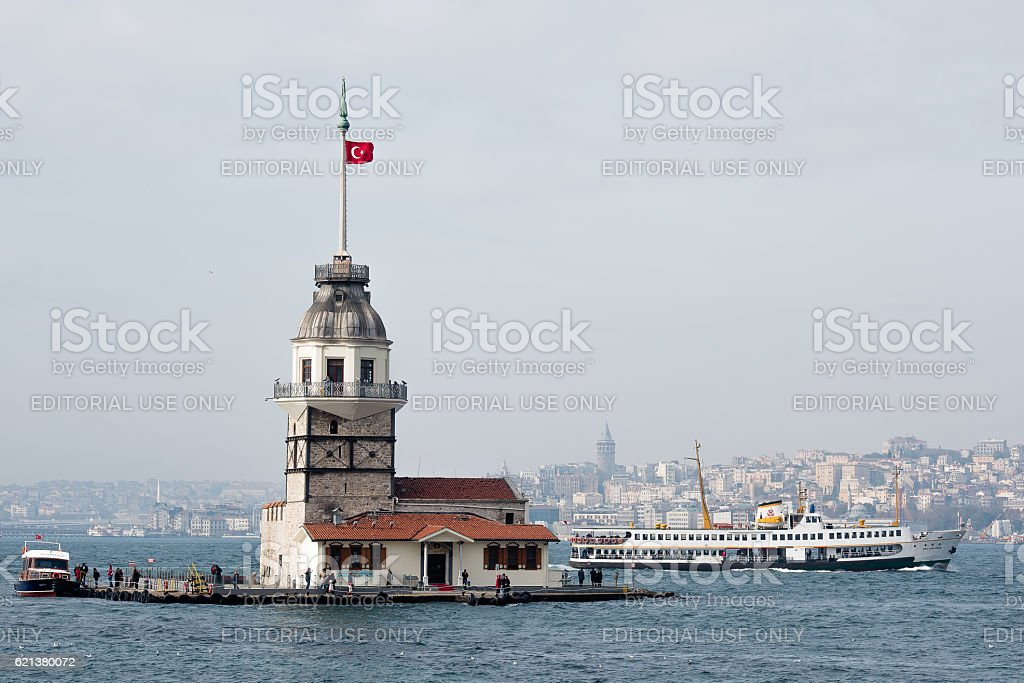 Maidens Tower and passenger ferry of Istanbul stock photo