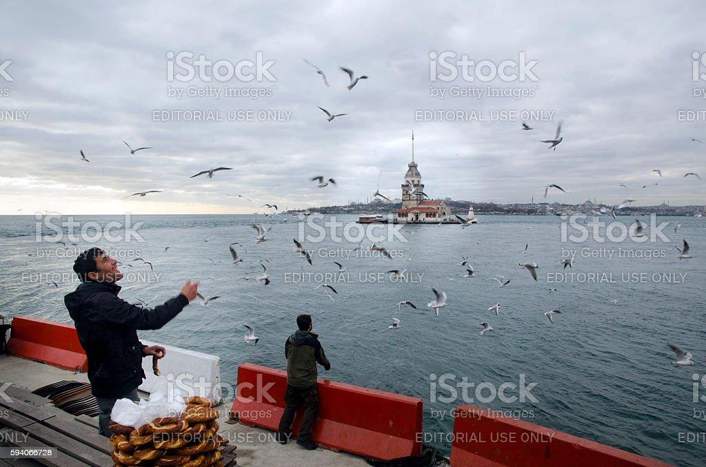 Maidens Tower in Istanbul, Turkish bagel salesman stock photo