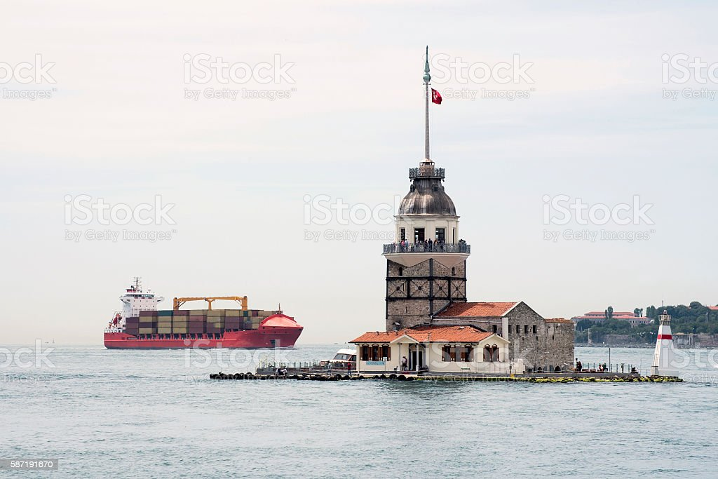 Maiden's Tower with Cargo Ship in Istanbul stock photo