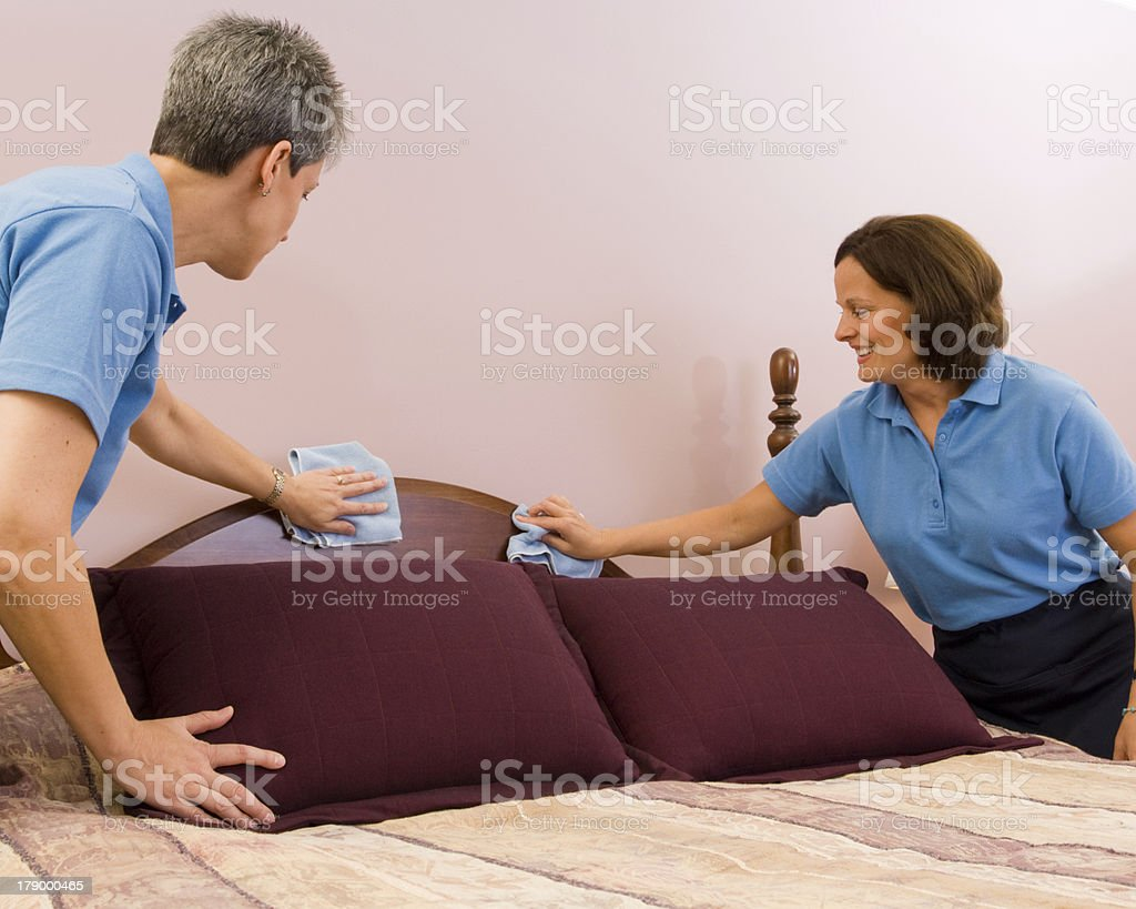 Maids Making a Bed stock photo
