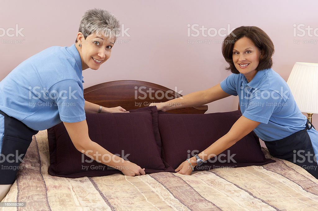 Maids Making A Hotel Room Bed stock photo
