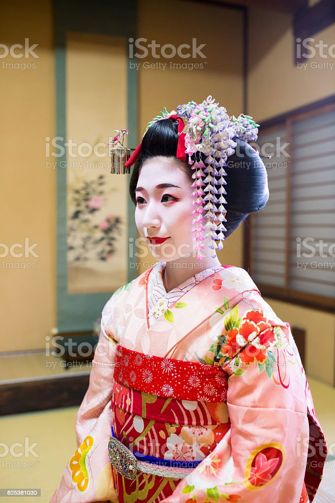 Maiko girl sitting in Japanese tatami room with smile stock photo