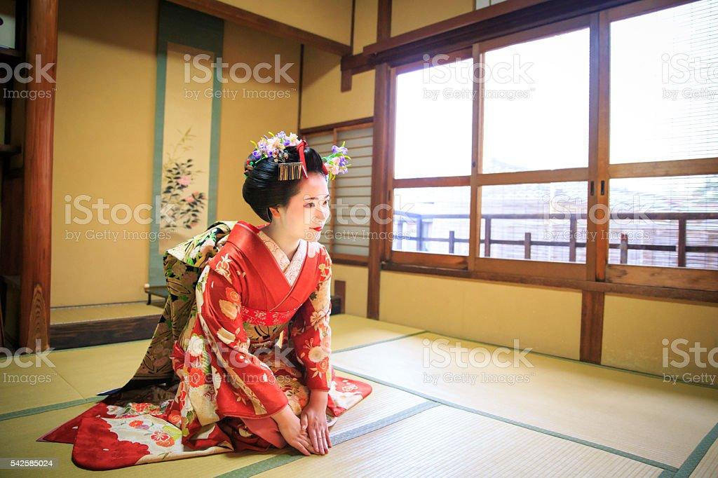 Maiko girl sitting in tatami room for greetings stock photo