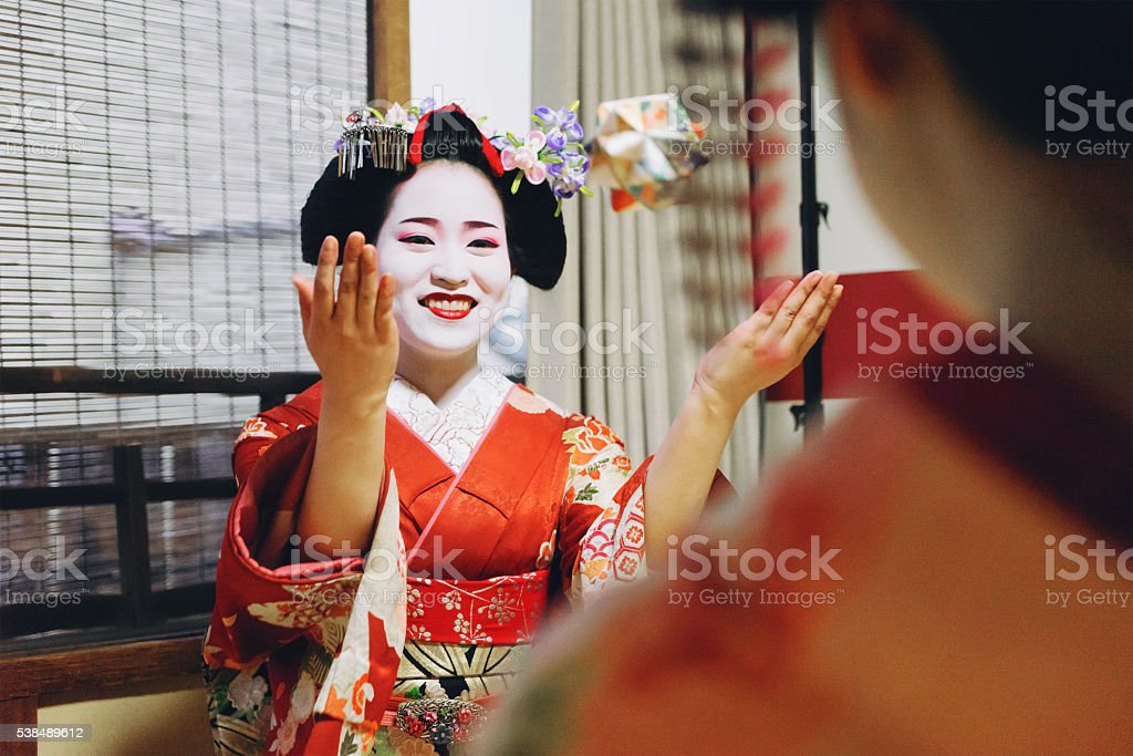 Maiko Girls Playing With Origami Paper stock photo