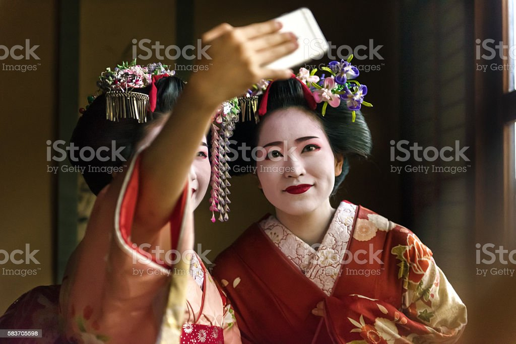 Maiko Girls taking selfie stock photo