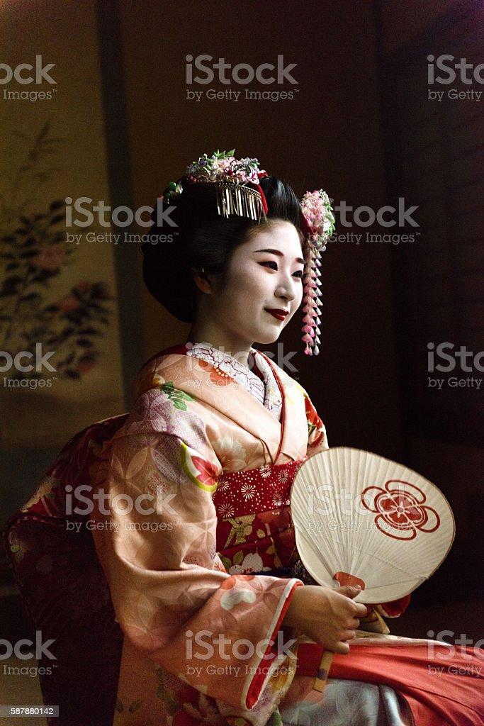 Maiko holding a hand fan stock photo