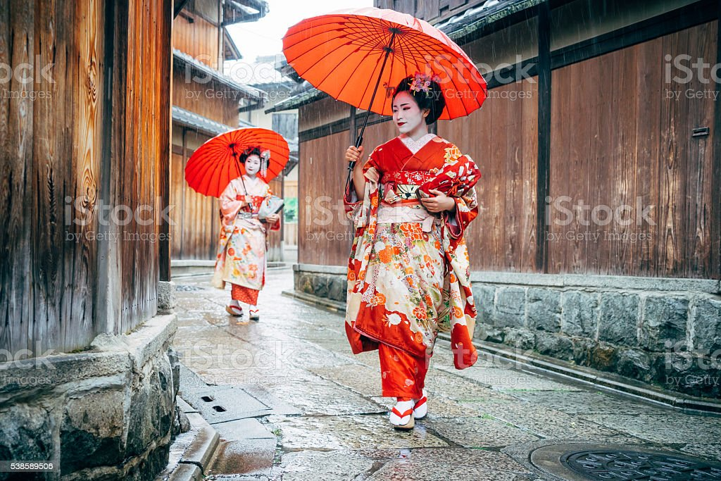 Maiko Women Walking in Kyoto stock photo