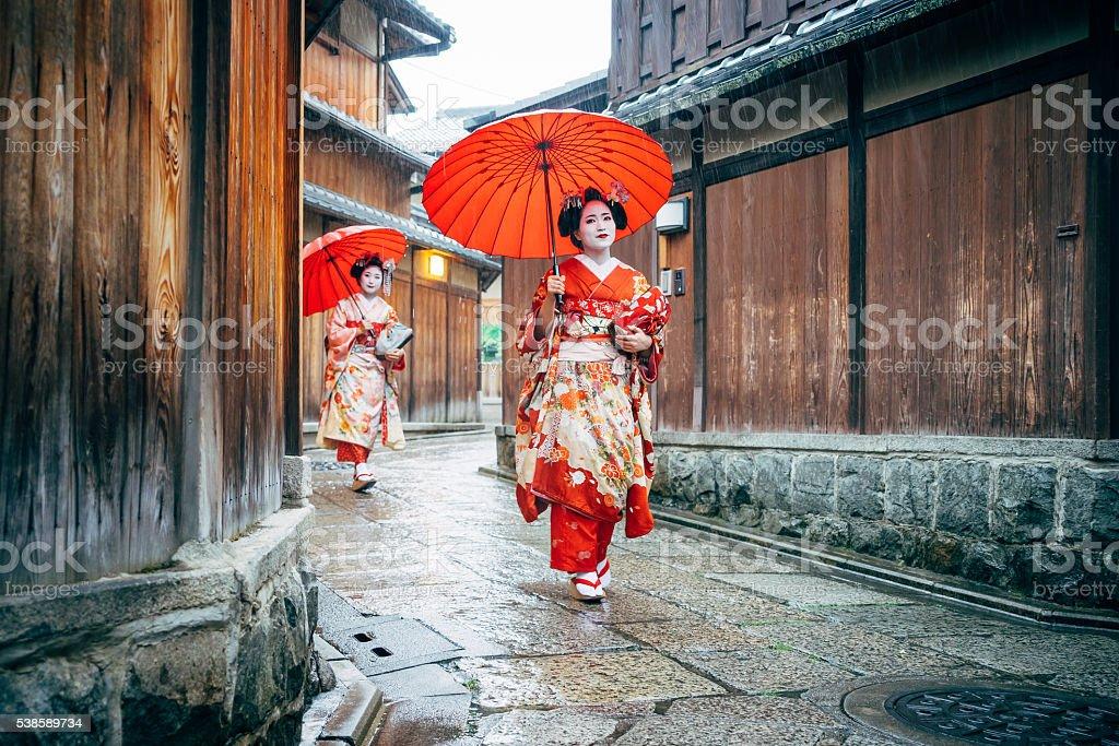 Maiko Women Walking in Kyoto stock photo
