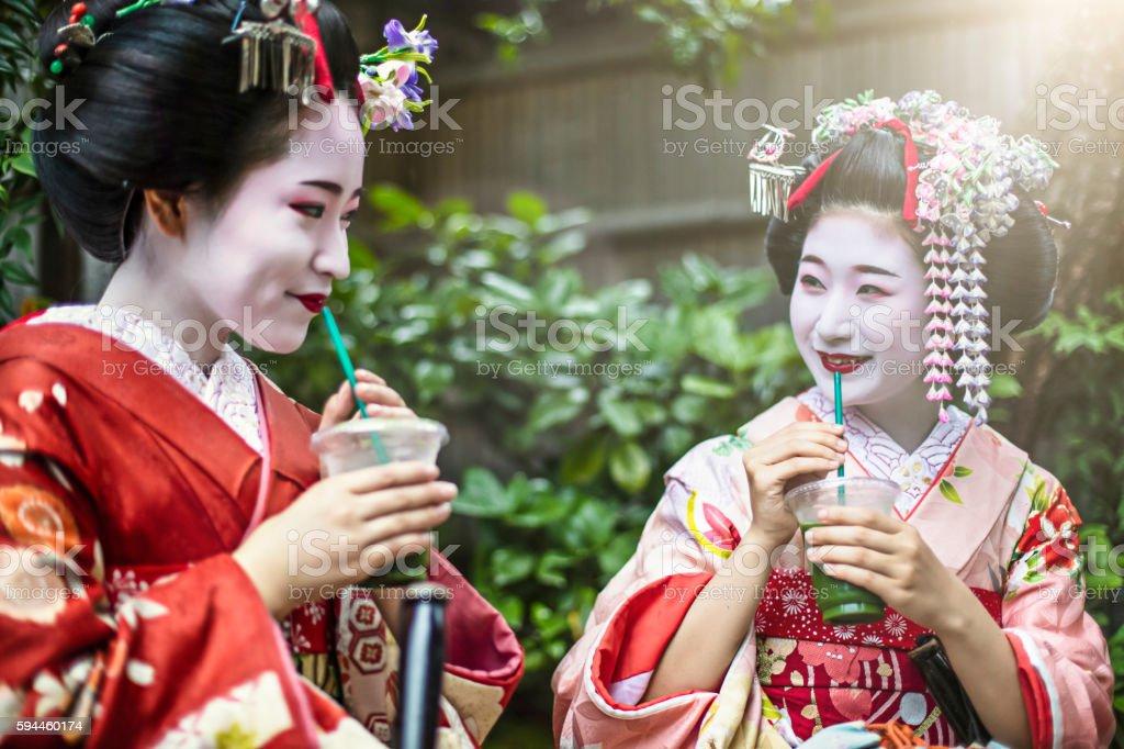 Maikos having ice green tea drink in Gion stock photo