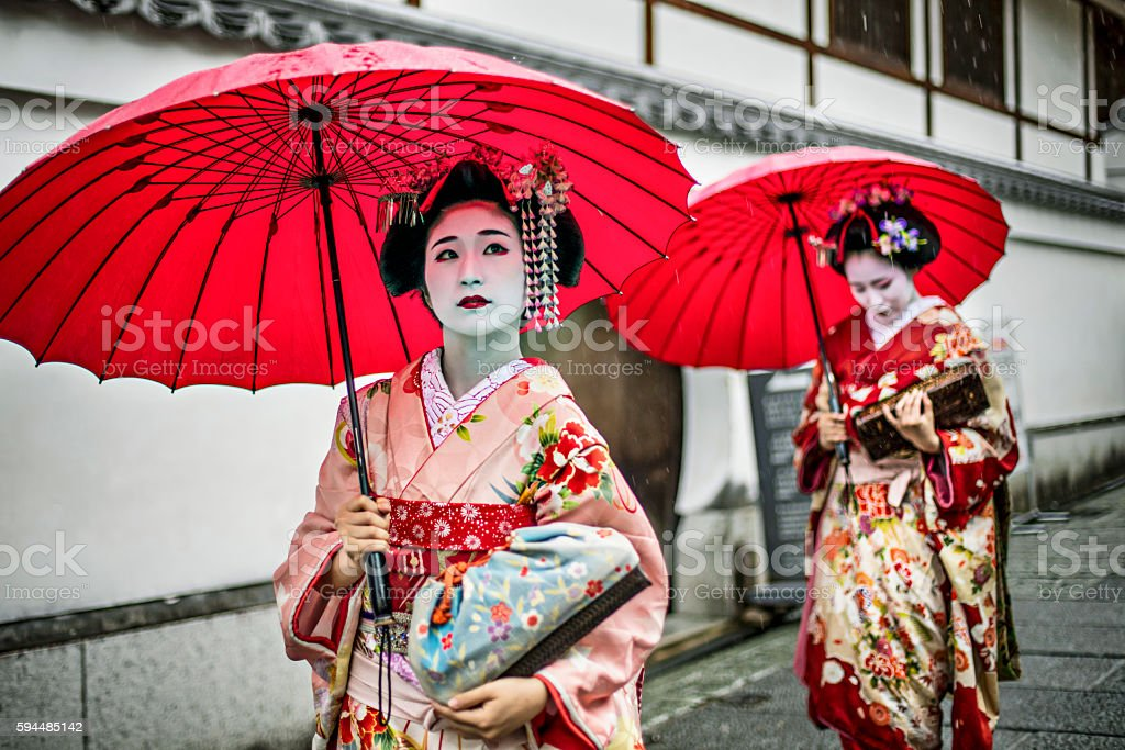 Maikos walking in the streets of Kyoto stock photo