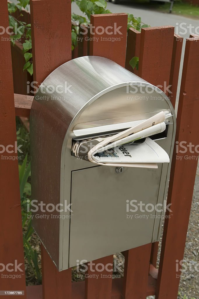Mail box with newspaper. stock photo
